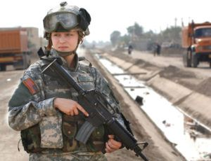 Pfc. Janelle Zalkovsky of the Civil Affairs Unit, 1st Battalion, 320th Field Artillery Regiment, 101st Airborne provides security while other Soldiers survey a newly constructed road in Ibriam Jaffes, Iraq, Dec. 4, 2005. The road project was initiated by the Civil Affairs Unit and cooperation with local officials to provide better access to the village from other main travel routes.(U.S. Army photo by Spc. Charles W. Gill) (Released)