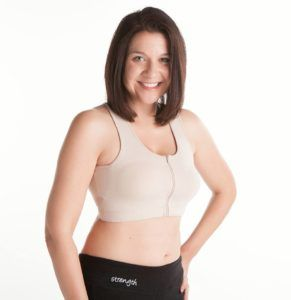 woman wearing zipper sports bra for post surgery for breast cancer
