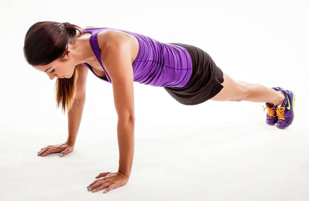 girl in purple tank doing plank exercise