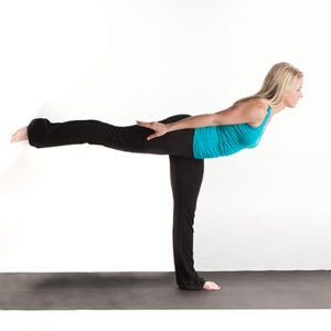 girl doing standing yoga pose